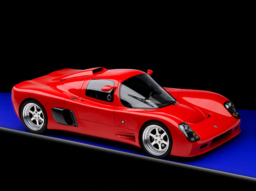 AUT 40 RK0280 01 © Kimball Stock 2005 Ultima GTR Red 3/4 Front View On Blue Floor Studio