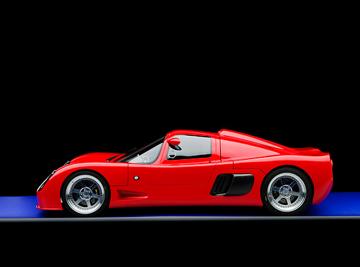 AUT 40 RK0285 01 © Kimball Stock 2005 Ultima GTR Red Profile View On Blue Floor Gray Line Studio