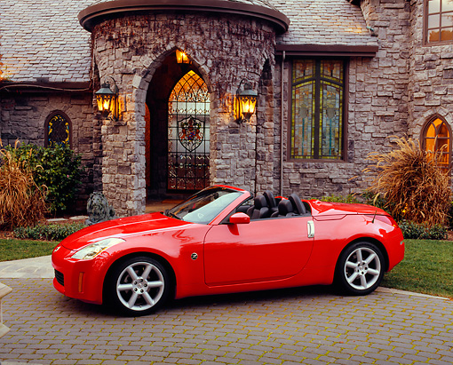AUT 40 RK0290 01 © Kimball Stock 2004 Nissan 350Z Roadster Red 3/4 Front View By House