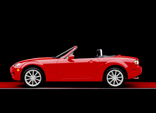 AUT 41 RK0042 04 © Kimball Stock 2006 Mazda, MX5, Miata, Convertible, Red Profile Shot On Red Floor Gray Line Studio