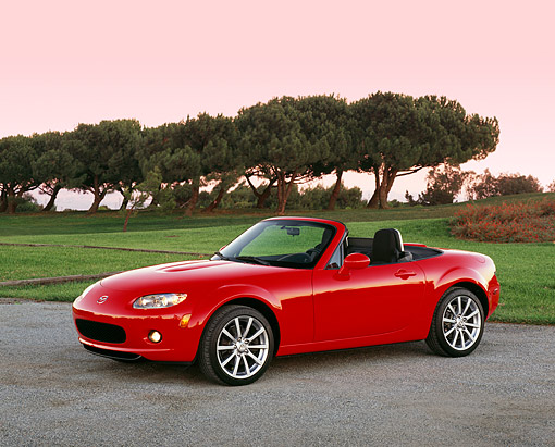 AUT 41 RK0045 02 © Kimball Stock 2006 Mazda, MX5, Miata, Convertible, Red 3/4 Side View On Pavement By Golf Course