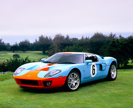 AUT 41 RK0025 03 © Kimball Stock 2006 Ford GT Light Blue And Orange 3/4 Front View On Grass By Trees