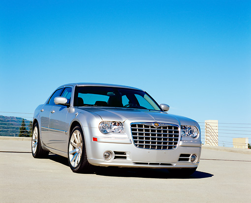 AUT 41 RK0036 01 © Kimball Stock 2006 Chrysler 300 SRT8 Silver 3/4 Front View On Pavement Blue Sky