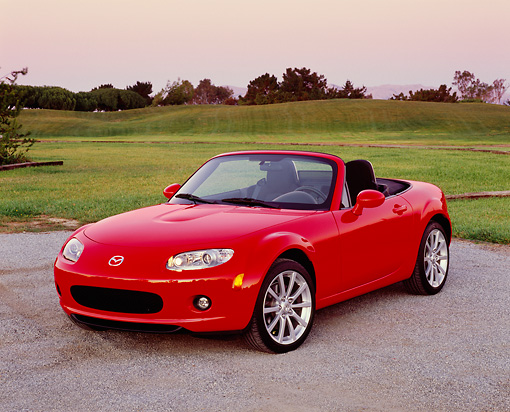 AUT 41 RK0044 02 © Kimball Stock 2006 Mazda, MX5, Miata, Convertible, Red 3/4 Front View On Pavement By Golf Course