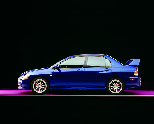 AUT 41 RK0052 06 © Kimball Stock 2006 Mitsubishi, Lancer Evolution, Blue Profile View On Purple Floor Studio