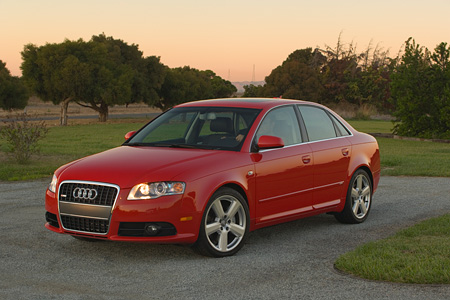 AUT 41 RK0082 01 © Kimball Stock 2006 Audi, A4, 2.0 T, Red  Front 3/4 View On Pavement  By Grass Hills