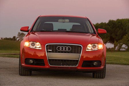 AUT 41 RK0084 01 © Kimball Stock 2006 Audi, A4, 2.0 T, Red Low Head On View On Pavement By Grass Hills