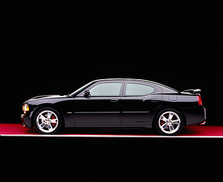 AUT 41 RK0108 06 © Kimball Stock 2006 Dodge, Charger SRT8, Black Profile On Red Floor  Studio