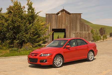 AUT 41 RK0141 01 © Kimball Stock 2006 Mazdaspeed6 Red 3/4 Side View On Pavement By Barn And Trees