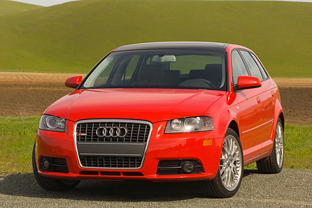 AUT 41 RK0144 01 © Kimball Stock 2006 Audi A3 3.2 S-Line Red 3/4 Front View On Pavement By Grass Hills