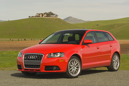 AUT 41 RK0145 01 © Kimball Stock 2006 Audi A3 3.2 S-Line Red 3/4 Front View On Pavement By Grass Hills