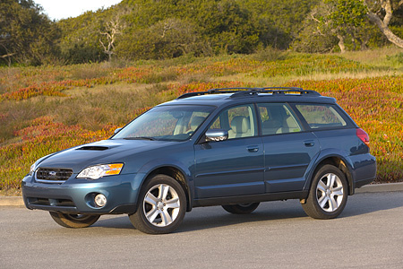 AUT 41 RK0150 01 © Kimball Stock 2006 Subaru Outback 2.5XT Wagon Blue 3/4 Side View On Pavement By Grass And Trees