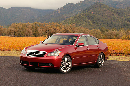 AUT 41 RK0198 01 © Kimball Stock 2006 Infiniti M45 Red 3/4 Front View On Pavement On Pavement By Hills And Trees