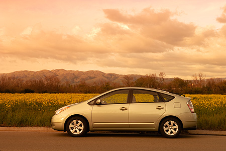 AUT 41 RK0205 01 © Kimball Stock 2006 Toyota Prius Hybrid Light Green Profile View On Pavement Flower Field