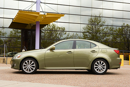 AUT 41 RK0206 01 © Kimball Stock 2006 Lexus IS350 Green Profile Shot On Pavement By Glass Building
