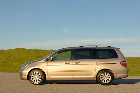 AUT 41 RK0256 01 © Kimball Stock 2006 Honda Odyssey Touring Desert Rock Mist Profile View On Pavement By Grass Hills