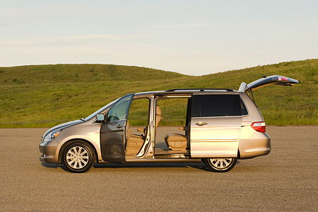 AUT 41 RK0258 01 © Kimball Stock 2006 Honda Odyssey Touring Desert Rock Mist Profile View On Pavement By Grass  Hills Doors Open