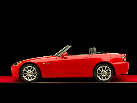AUT 41 RK0321 01 © Kimball Stock 2006 Honda S2000 Convertible Red Profile Shot On Red Floor Studio