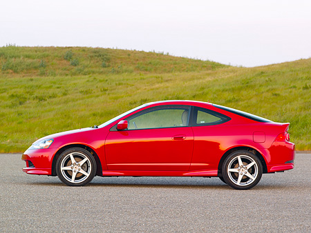 AUT 41 RK0326 01 © Kimball Stock 2006 Acura RSX Type S Red Profile View On Pavement By Grass Hills
