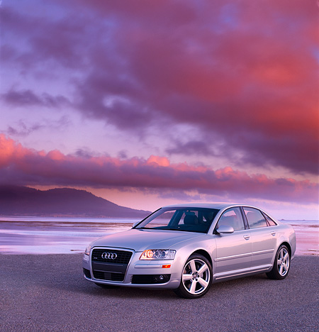 AUT 41 RK0396 01 © Kimball Stock 2006 Audi A8 Quattro AT6 Silver 3/4 Front View On Pavement By Water