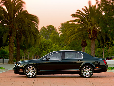 AUT 41 RK0469 01 © Kimball Stock 2006 Bentley Continental Flying Spur Black Profile View On Pavement By Trees