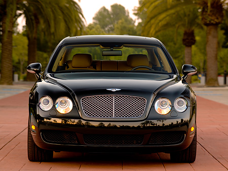 AUT 41 RK0470 01 © Kimball Stock 2006 Bentley Continental Flying Spur Black Low Head On View On Pavement By Trees