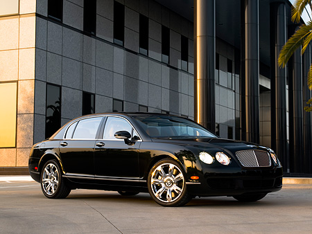 AUT 41 RK0471 01 © Kimball Stock 2006 Bentley Continental Flying Spur Black 3/4 Front View On Pavement By Building