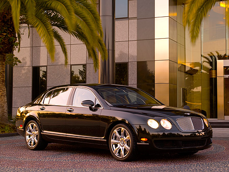 AUT 41 RK0472 01 © Kimball Stock 2006 Bentley Continental Flying Spur Black 3/4 Front View On Pavement By Building And Trees