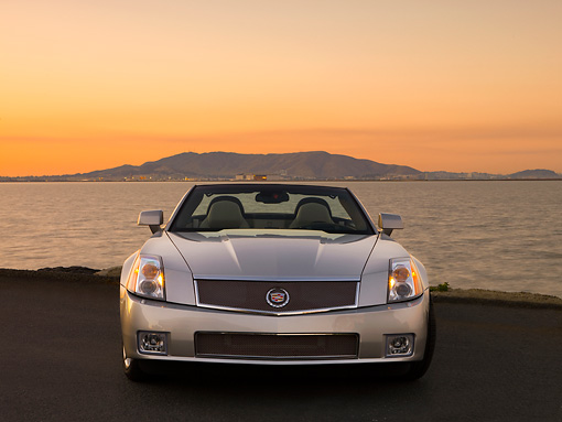 AUT 41 RK0525 01 © Kimball Stock 2006 Cadillac XLR-V Convertible Silver Head On View On Pavement