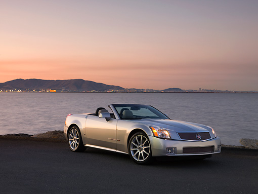 AUT 41 RK0527 01 © Kimball Stock 2006 Cadillac XLR-V Convertible Silver 3/4 Front View On Pavement