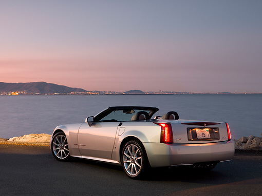 AUT 41 RK0528 01 © Kimball Stock 2006 Cadillac XLR-V Convertible Silver 3/4 Rear View On Pavement