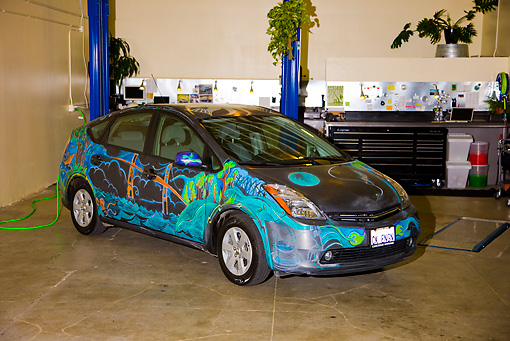 AUT 41 RK0559 01 © Kimball Stock 2006 Toyota Prius Multicolored 3/4 Front View In  Service Garage