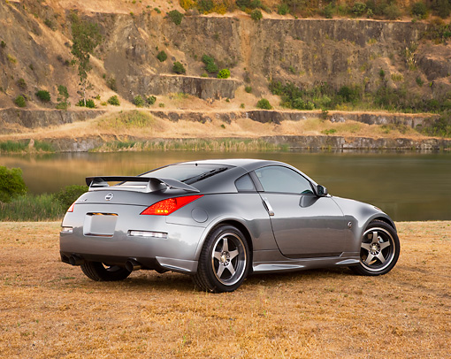 AUT 41 RK0574 01 © Kimball Stock 2006 Nissan 350Z Silver 3/4 Rear View At Quarry