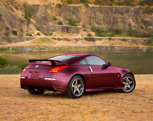 AUT 41 RK0575 01 © Kimball Stock 2006 Nissan 350Z Purple 3/4 Rear View At Quarry