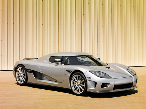 AUT 41 RK0576 01 © Kimball Stock 2006 Koenigsegg CCX Roadster Silver 3/4 Front View In Studio