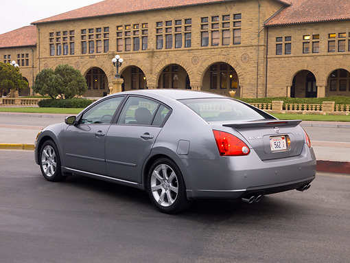 AUT 42 RK0092 01 © Kimball Stock 2007 Nissan Maxima 3.5 SE Gray 3/4 Rear View On Pavement By Building