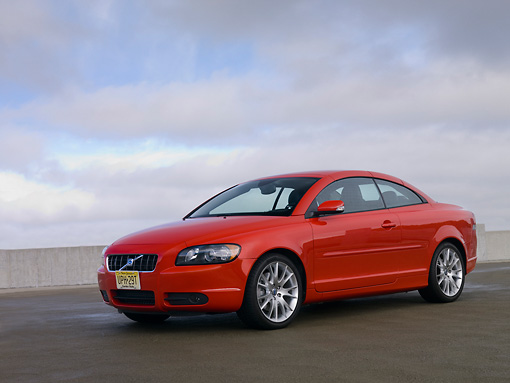 AUT 42 RK0100 01 © Kimball Stock 2007 Volvo C70 Red Low 3/4 Front View On Pavement