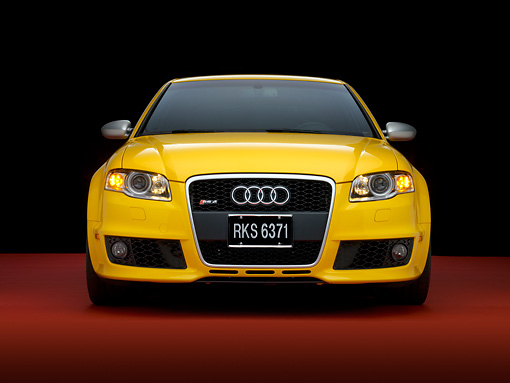 AUT 42 RK0107 04 © Kimball Stock 2007 Audi RS4 Yellow Head On View Studio