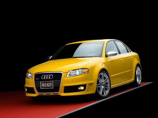 AUT 42 RK0108 02 © Kimball Stock 2007 Audi RS4 Yellow 3/4 Front View Studio