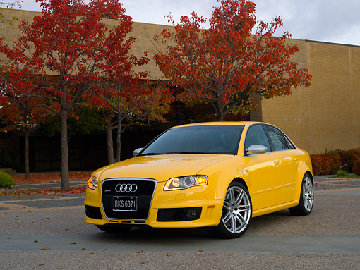 AUT 42 RK0109 02 © Kimball Stock 2007 Audi RS4 Yellow 3/4 Front View On Pavement By Fall Trees