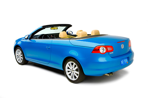 AUT 42 RK0129 01 © Kimball Stock 2007 Volkswagen Eos 2.0T Convertible Blue 3/4 Rear View Studio