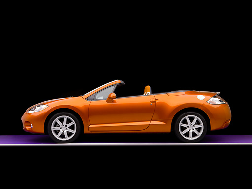 AUT 42 RK0131 02 © Kimball Stock 2007 Mitsubishi Eclipse Spyder GT Orange Profile View Studio