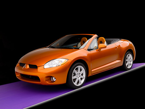 AUT 42 RK0132 01 © Kimball Stock 2007 Mitsubishi Eclipse  Spyder GT Orange 3/4 Front View Studio