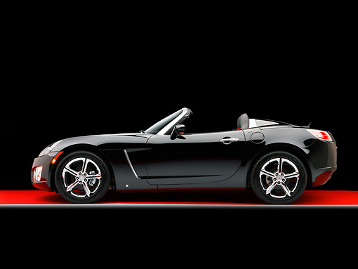 AUT 42 RK0133 02 © Kimball Stock 2007 Saturn Sky Turbo Convertible Black Profile View On Red Floor Studio