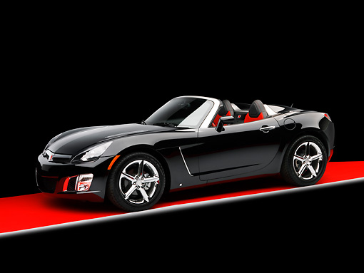 AUT 42 RK0134 02 © Kimball Stock 2007 Saturn Sky Turbo Convertible Black 3/4 Side View On Red Floor Studio