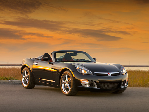 AUT 42 RK0137 01 © Kimball Stock 2007 Saturn Sky Turbo Convertible Black Low 3/4 Front View On Pavement