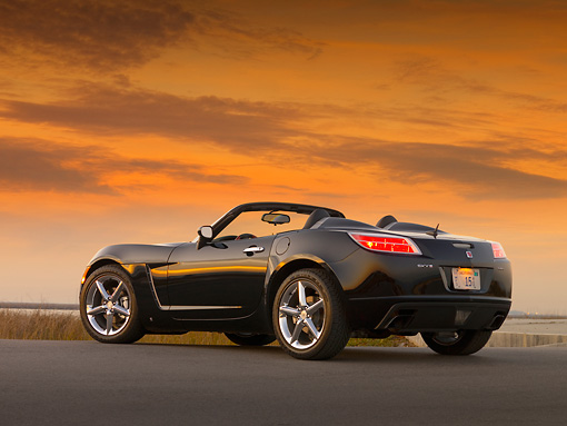 AUT 42 RK0140 01 © Kimball Stock 2007 Saturn Sky Turbo Convertible Black Low 3/4 Rear View On Pavement