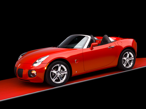 AUT 42 RK0146 01 © Kimball Stock 2007 Pontiac Solstice GXP Convertible Red 3/4 Side View Studio