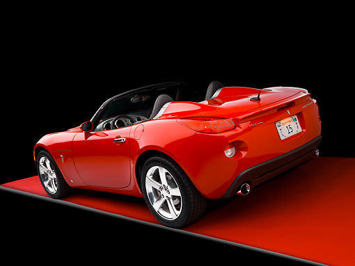 AUT 42 RK0147 01 © Kimball Stock 2007 Pontiac Solstice GXP Convertible Red 3/4 Rear View Studio