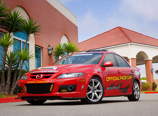 AUT 42 RK0206 01 © Kimball Stock 2007 Mazda Speed 6 Official Pace Car Red Low 3/4 Front View On Pavement